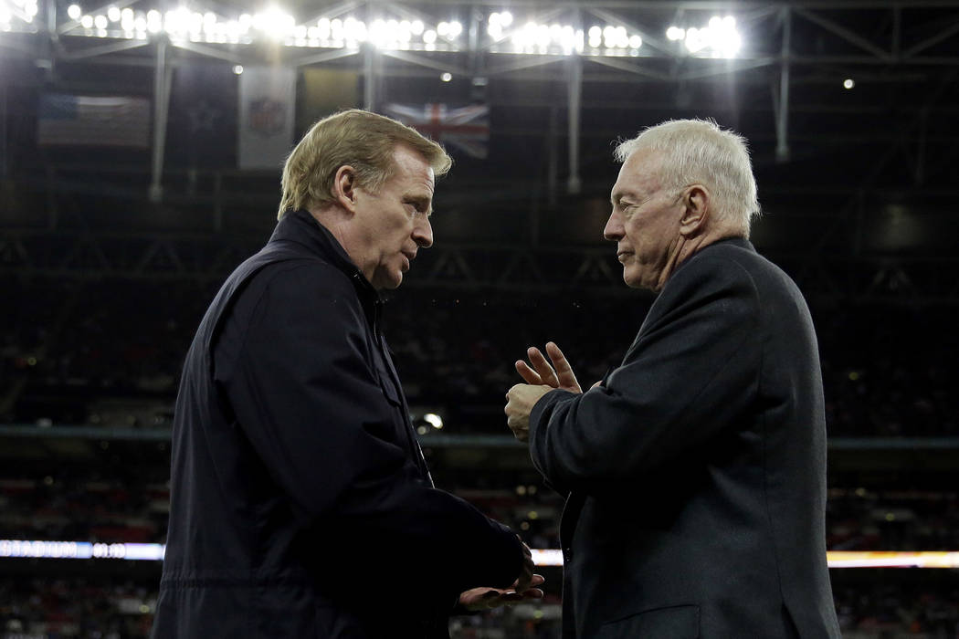 In this Nov. 9, 2014, file photo, NFL commissioner Roger Goodell, left, and Dallas Cowboys owner Jerry Jones talk during an NFL football game between the Jacksonville Jaguars and Dallas Cowboys at ...