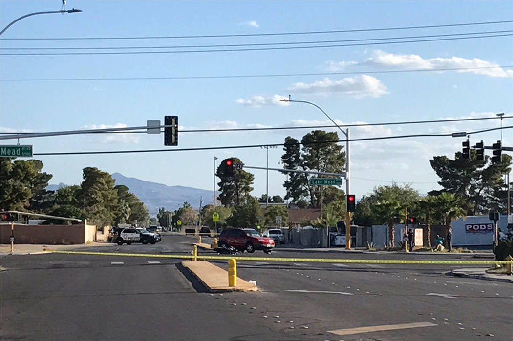 The scene of a fatal motorcycle crash at the intersection of Lake Mead Boulevard and Christy Lane on Sunday in Las Vegas. (Blake Apgar/Las Vegas Review-Journal)