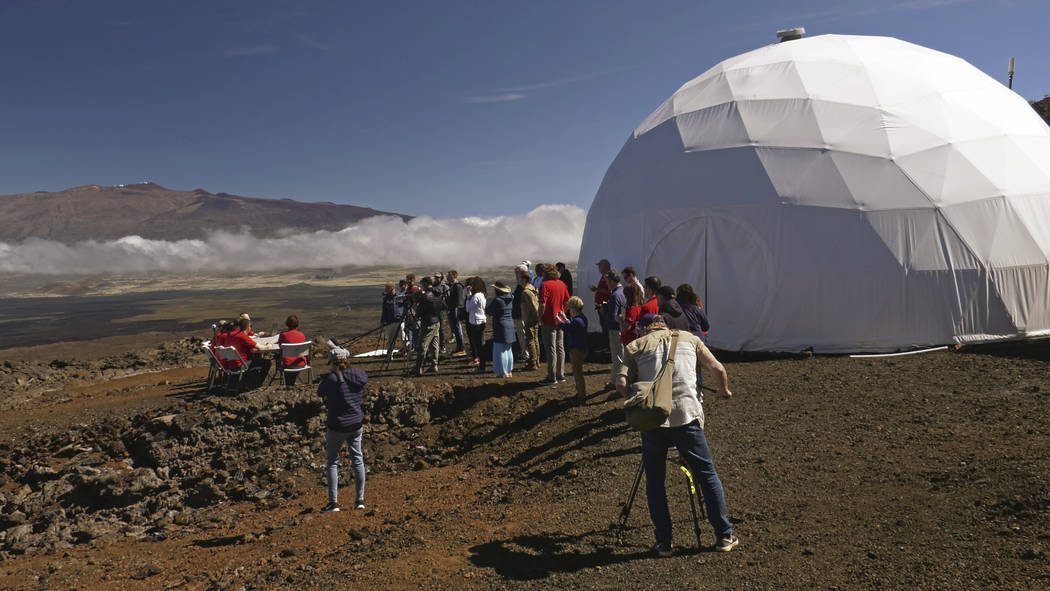 HI-SEAS crew members, left, sit for a news conference after emerging from their habitat on Sunday, Sept. 17, 2017, after eight months of living in isolation in a Mars-like habitat in Mauna Loa vol ...