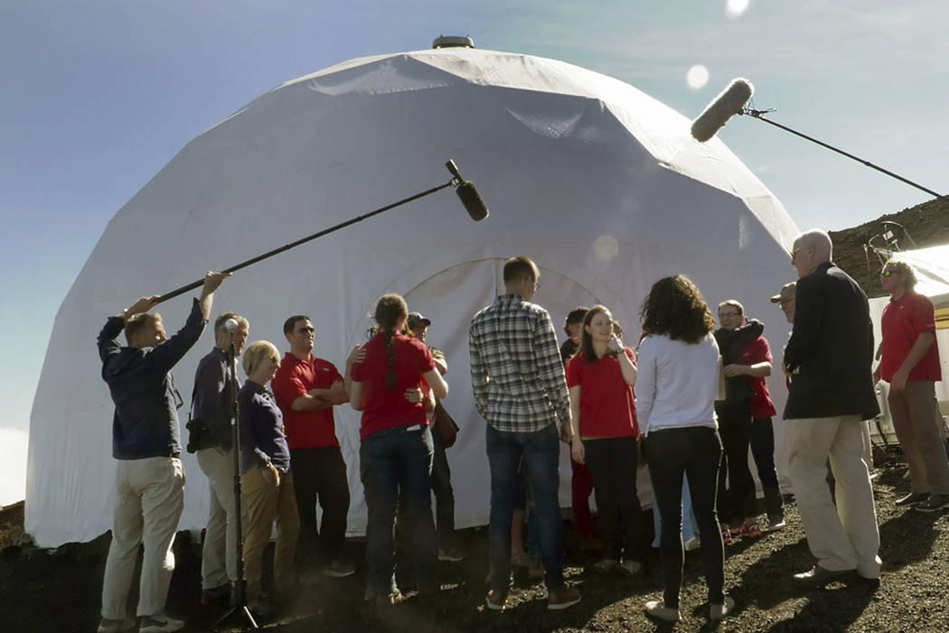 HI-SEAS crew members emerge from their habitat on Sunday, Sept. 17, 2017, after eight months of living in isolation in a Mars-like habitat in Mauna Loa volcano, Big Island, Hawaii. (HI-SEAS V crew ...