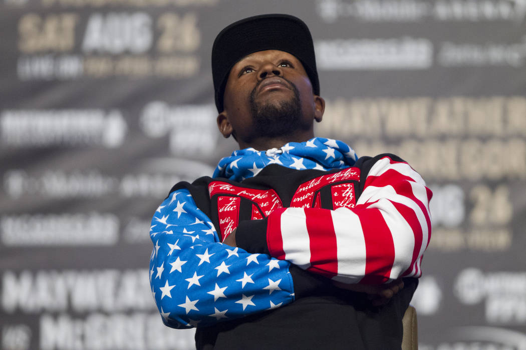 Floyd Mayweather Jr. poses during a world tour event stop to promote his fight against UFC fighter Conor McGregor, at Staples Center in Los Angeles, Calif., on Tuesday, July 11, 2017. (Erik Verduz ...