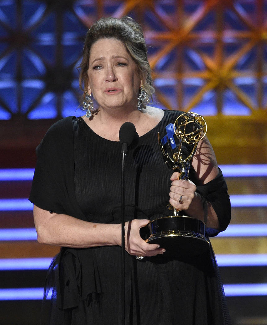 "Ann Dowd accepts the award for outstanding supporting actress in a drama series for ""The Handmaid's Tale"" at the 69th Primetime Emmy Awards on Sunday, Sept. 17, 2017, at the Micr ..."
