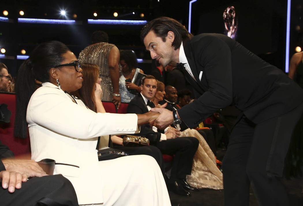 Oprah Winfrey, left, and Milo Ventimiglia appear in the audience at the 69th Primetime Emmy Awards on Sunday, Sept. 17, 2017, at the Microsoft Theater in Los Angeles. (Photo by John Salangsang/Inv ...