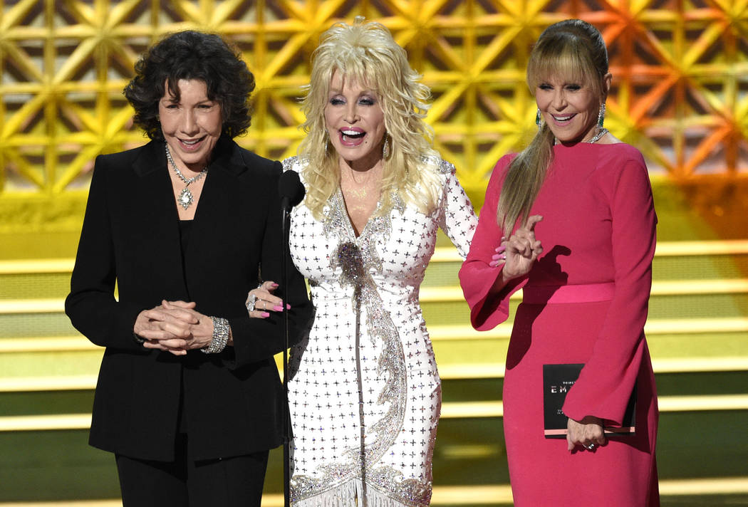 Lily Tomlin, from left, Dolly Parton and Jane Fonda present the award for outstanding supporting actor in a limited series or a movie at the 69th Primetime Emmy Awards on Sunday, Sept. 17, 2017, a ...