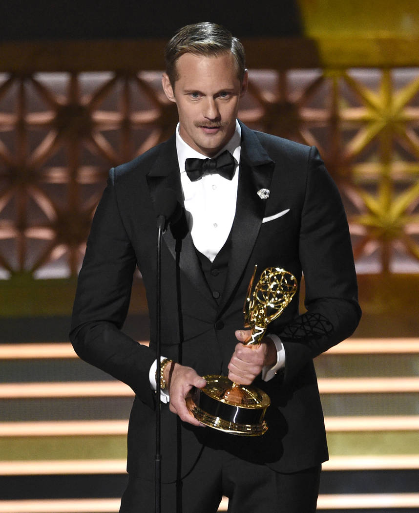 "Alexander Skarsgard accepts the award for outstanding supporting actor in a limited series or a movie for ""Big Little Lies"" at the 69th Primetime Emmy Awards on Sunday, Sept. 17, ..."