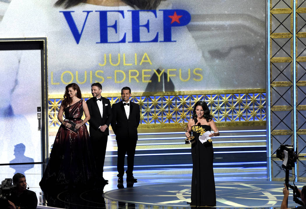 "Julia Louis-Dreyfus accepts the award for outstanding lead actress in a comedy series for ""Veep"" at the 69th Primetime Emmy Awards on Sunday, Sept. 17, 2017, at the Microsoft The ..."
