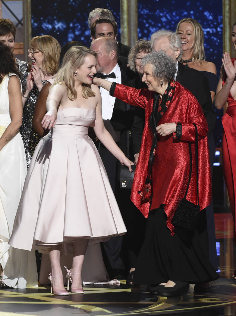 "Elisabeth Moss, left, and author Margaret Atwood embrace as ""The Handmaid's Tale"" wins the award for outstanding drama series at the 69th Primetime Emmy Awards on Sunday, Sept. 1 ..."