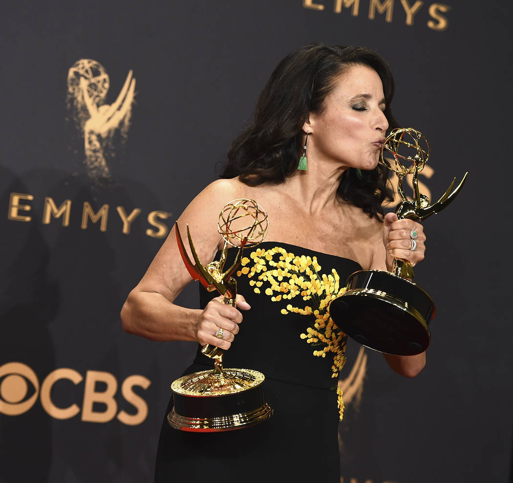 "Julia Louis-Dreyfus poses in the press room with her awards for outstanding lead actress in a comedy series and outstanding comedy series for ""Veep"" at the 69th Primetime Emmy Aw ..."
