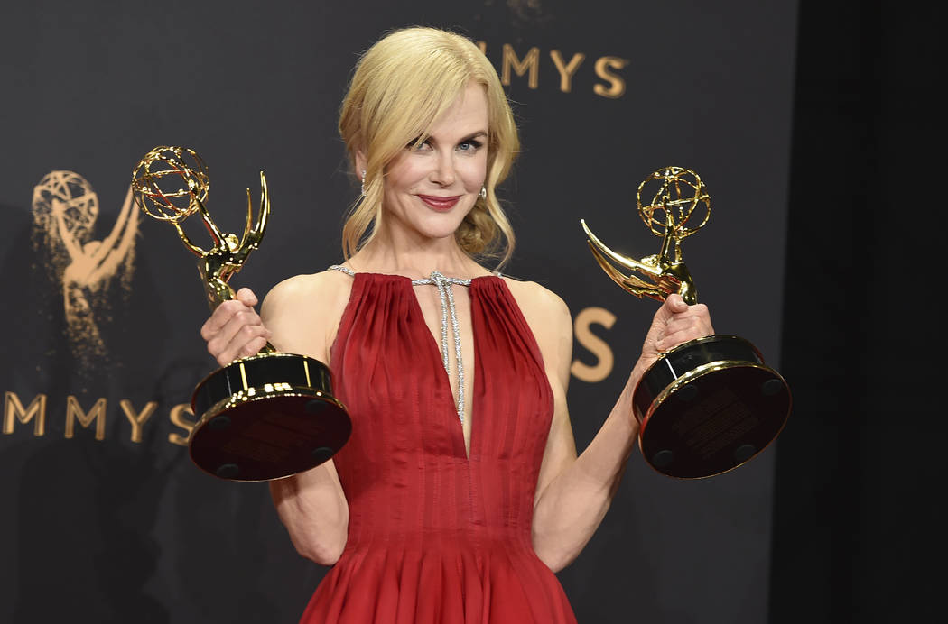 "Nicole Kidman poses with her awards for outstanding lead actress in a limited series or a movie and outstanding limited series for ""Big Little Lies"" in the press room at the 69th ..."