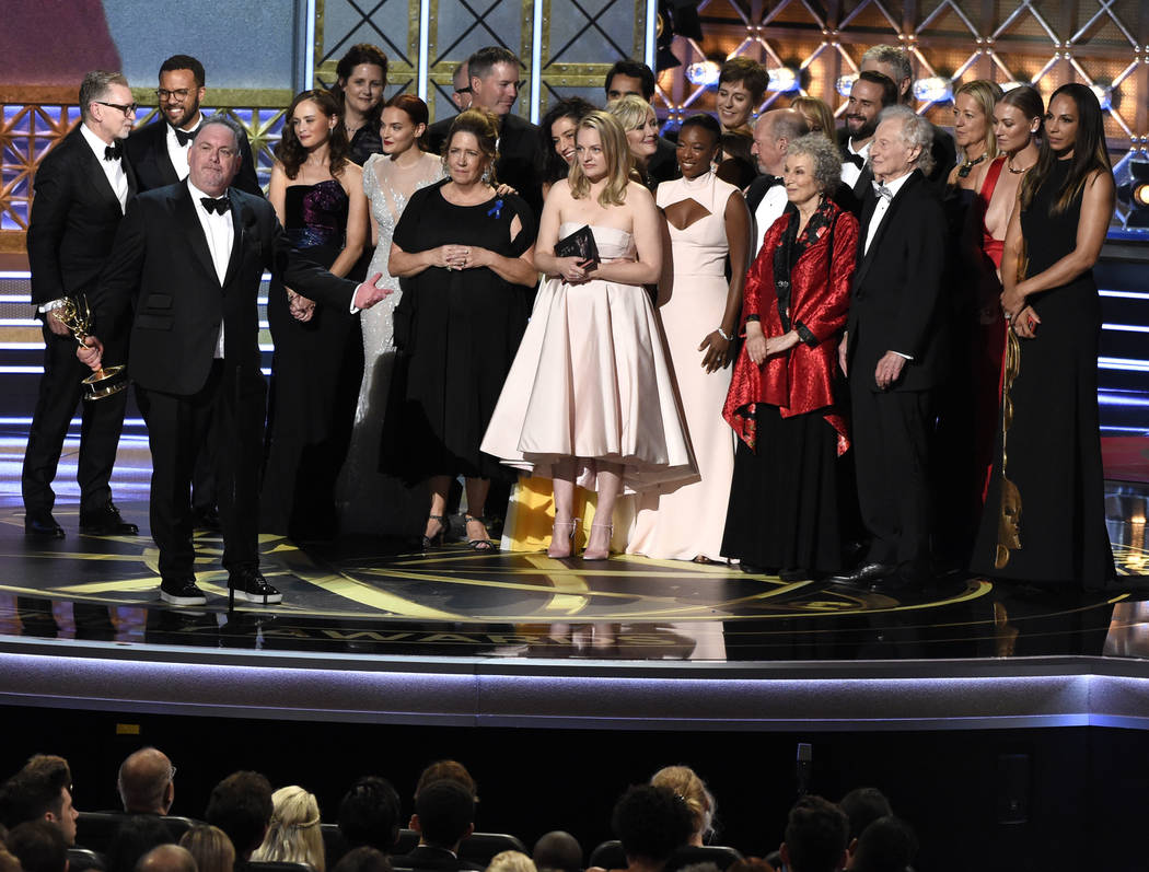 "Bruce Miller and the cast and crew accept the award for outstanding drama series for ""The Handmaid's Tale"" at the 69th Primetime Emmy Awards on Sunday, Sept. 17, 2017, at the Mic ..."