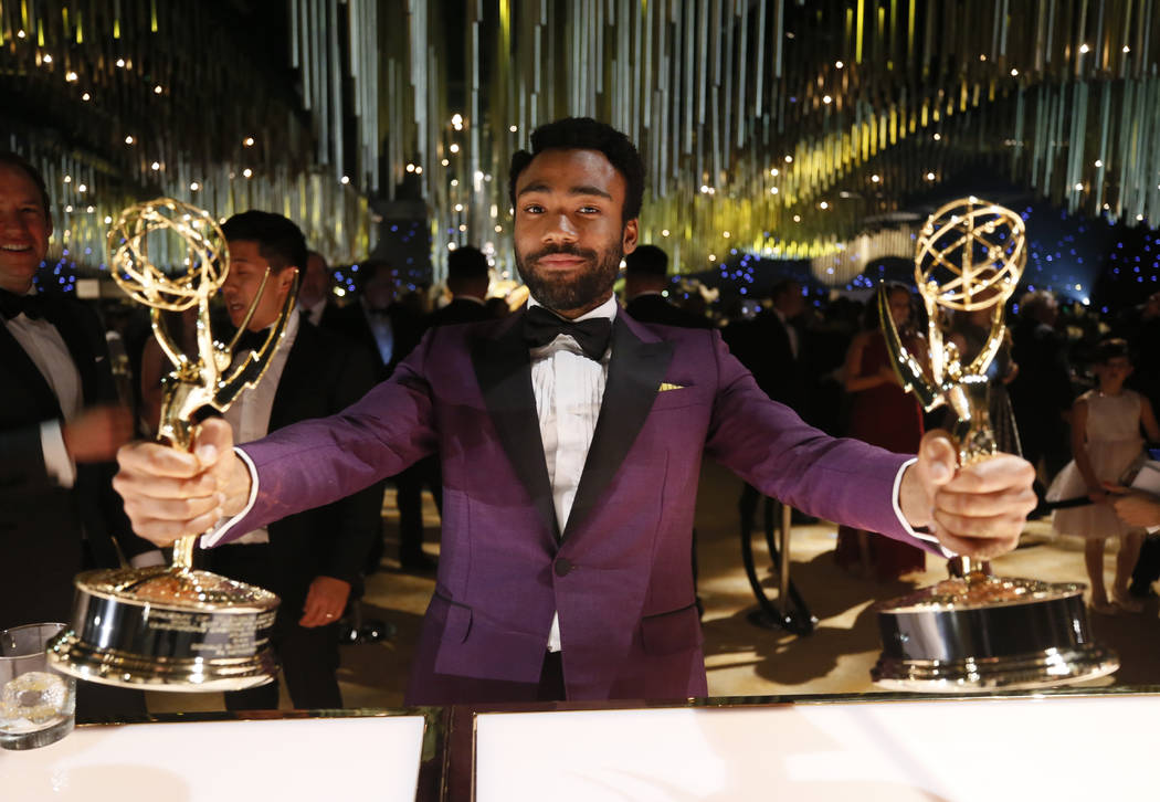 "EXCLUSIVE - Donald Glover poses with his awards for outstanding lead actor and directing for ""Atlanta"" attends the Governors Ball for the 69th Primetime Emmy Awards at the Los An ..."