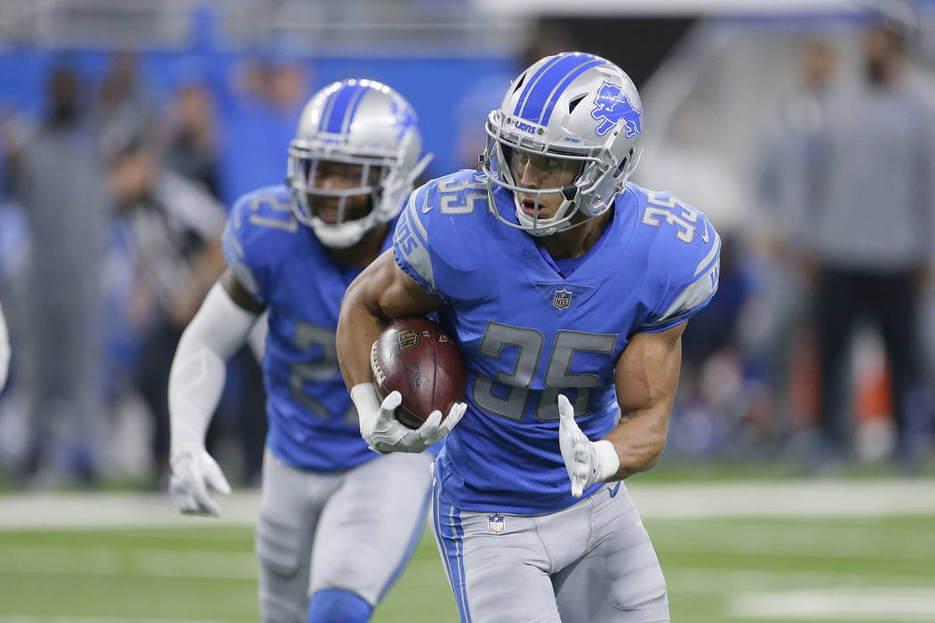 Detroit Lions strong safety Miles Killebrew (35) runs an interception back 35 yards for a touchdown against the Arizona Cardinals during the fourth quarter an NFL football game in Detroit, Sunday, ...