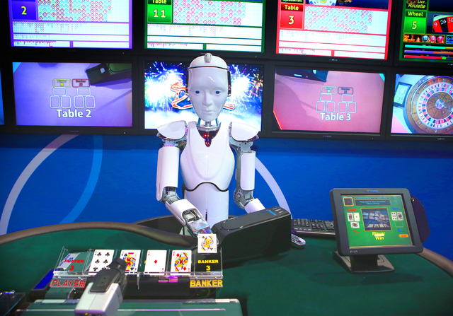A robot deals baccarat in the IGT booth during the Global Gaming Expo at the Las Vegas Sands Expo and Convention Center on Thursday , Sept. 29, 2016. Jeff Scheid/Las Vegas Review-Journal Follow @j ...