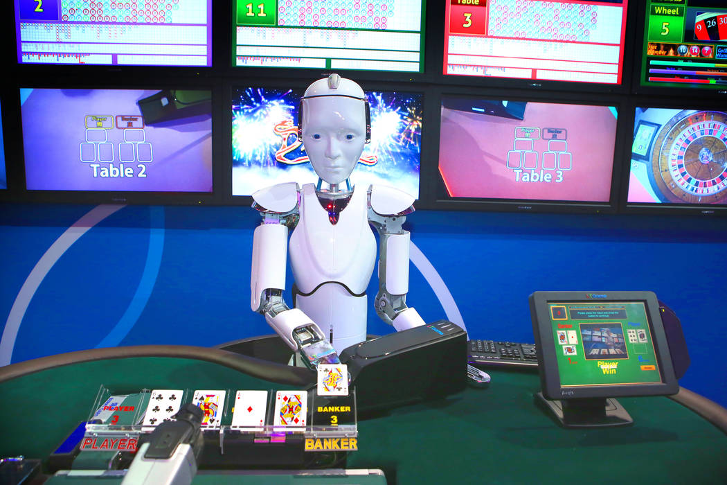 A robot deals baccarat in the IGT booth during the Global Gaming Expo at the Las Vegas Sands Expo and Convention Center on Thursday, Sept. 29, 2016. (Jeff Scheid/Las Vegas Review-Journal) @jeffscheid