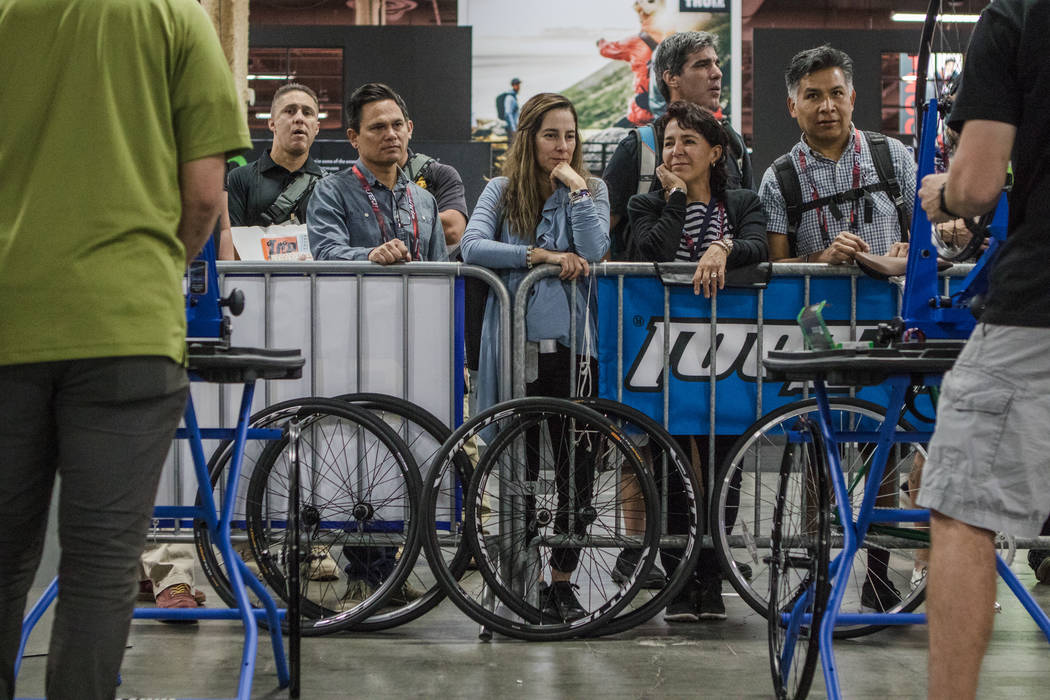 Spectators watch a mechanical bike challenge at the  Interbike International Expo at Mandalay Bay Convention Center on Wednesday, Sep. 20, 2017, in Las Vegas. Morgan Lieberman Las Vegas Review-Journal