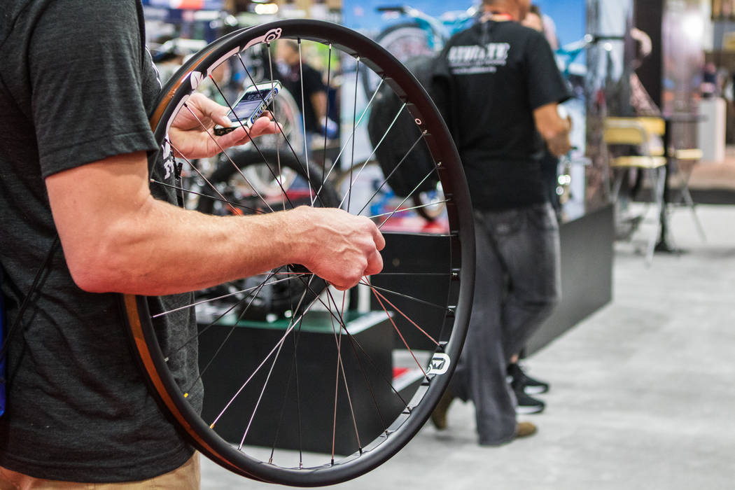 An attendee holds a bike whee at Interbike International Expo at Mandalay Bay Convention Center on Wednesday, Sep. 20, 2017, in Las Vegas. Morgan Lieberman Las Vegas Review-Journal