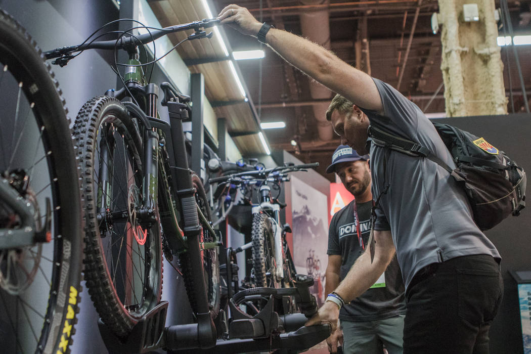 Las Vegas residents Matt Rozar, right, and Robert Hutchinson, left, check out the Thule bike racks at Interbike International Expo at Mandalay Bay Convention Center on Wednesday, Sep. 20, 2017, in ...