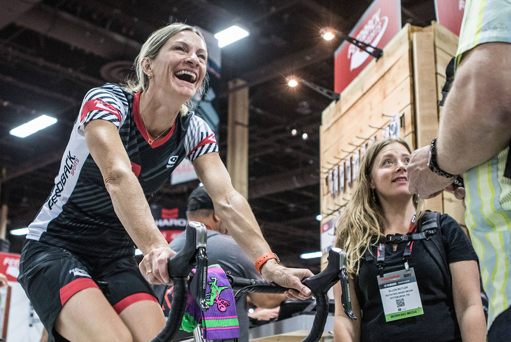 Colorado resident Lisa Hudson, left, cycles while talking to Pennsylvania resident Ellen Butler, right, at Interbike International Expo at Mandalay Bay Convention Center on Wednesday, Sep. 20, 201 ...