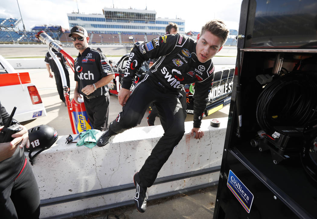 Noah Gragson jumps over the wall after winning the pole position for a NASCAR Truck Series auto race, Friday, June 23, 2017, at Iowa Speedway in Newton, Iowa. (AP Photo/Charlie Neibergall)
