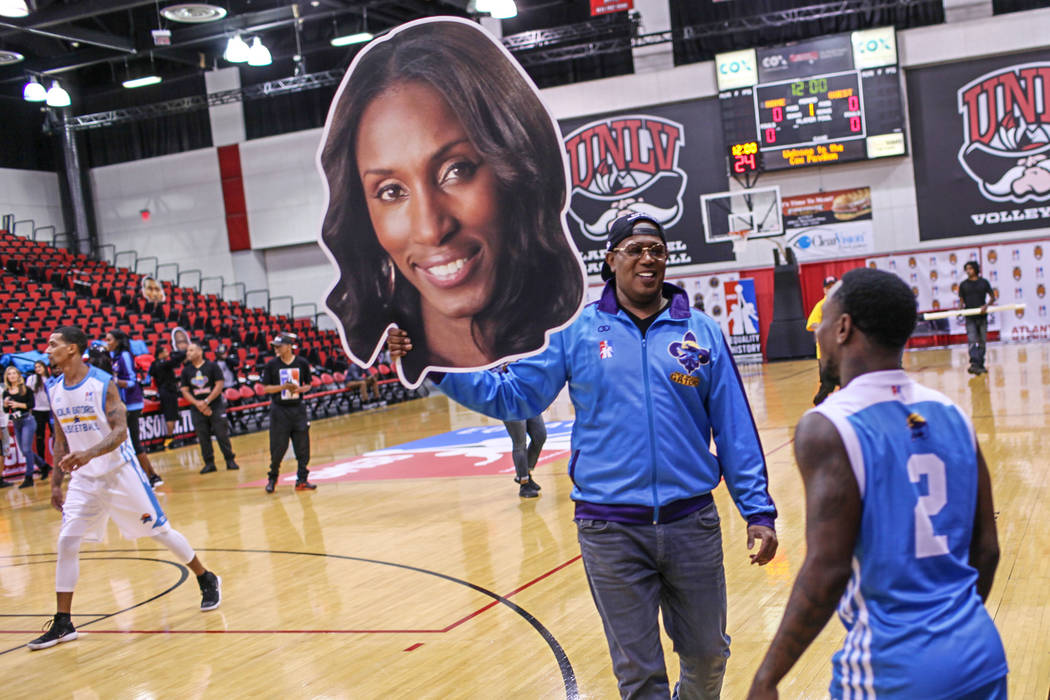 New Orleans Gators' owner Percy Miller holds a cut-out of coach Lisa Leslie during a basketball practice at the Cox Pavilion in Las Vegas, Friday, Sept. 22, 2017. The team is part of the newly-for ...