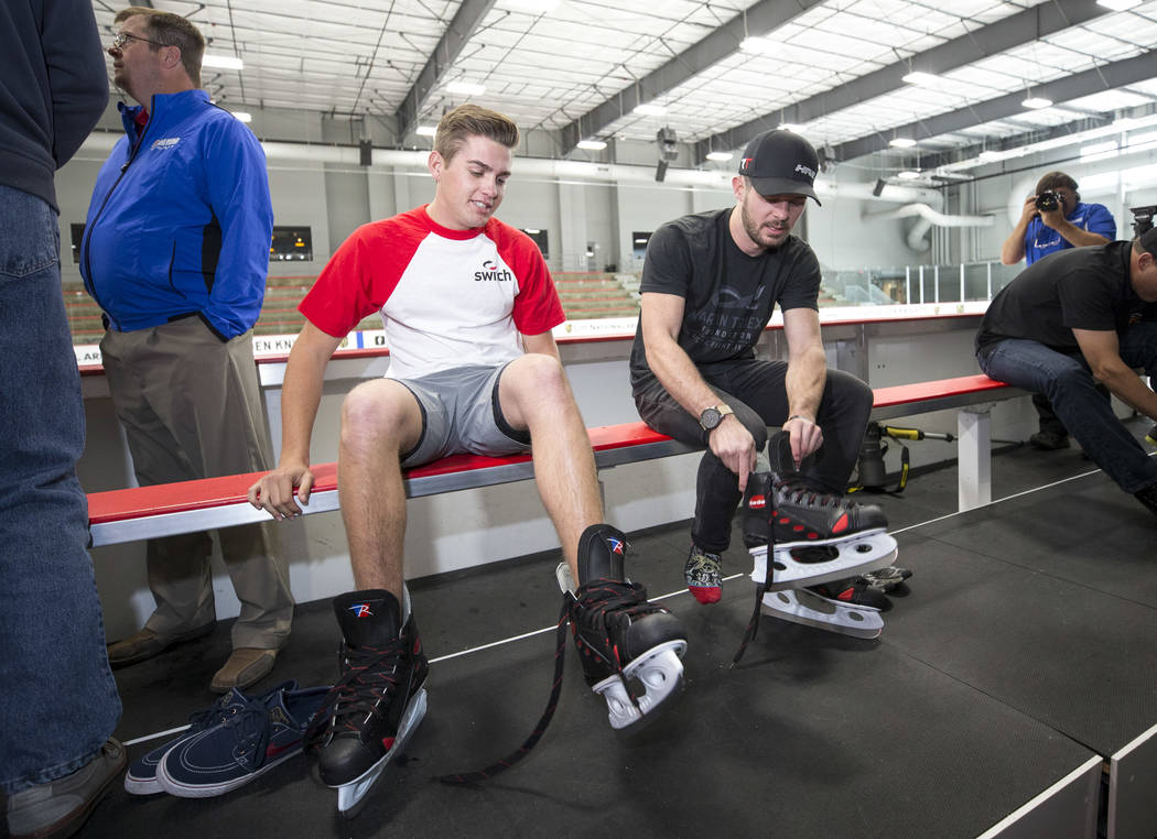 NASCAR Camping World Truck Series drivers Noah Gragson, left, and Ryan Truex lace up their ice skates before taking part in a ice hockey skills clinic with Vegas Golden Knights TV analyst Shane Hn ...