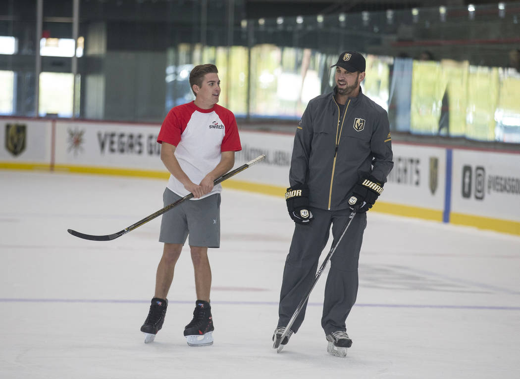 NASCAR Camping World Truck Series driver Noah Gragson, left, talks with Vegas Golden Knights TV analyst Shane Hnidy during an ice hockey skills clinic at City National Arena on Friday, Sept. 29, 2 ...