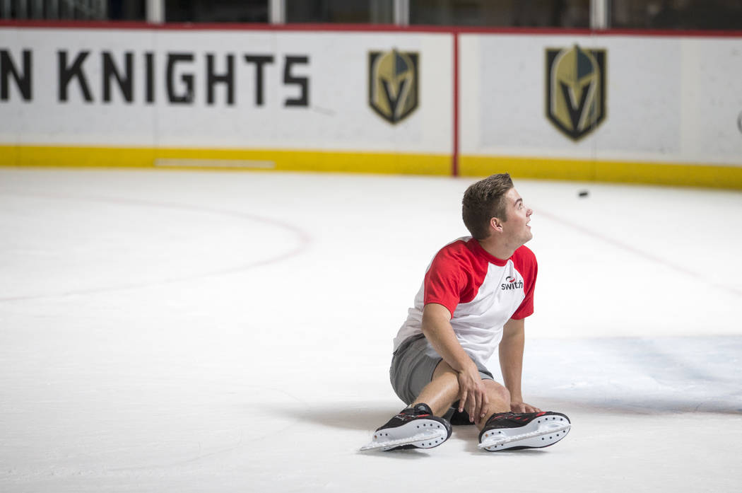 NASCAR Camping World Truck Series drivers Noah Gragson falls to the ice during an ice hockey skills clinic with Vegas Golden Knights TV analyst Shane Hnidy at the City National Arena on Friday, Se ...