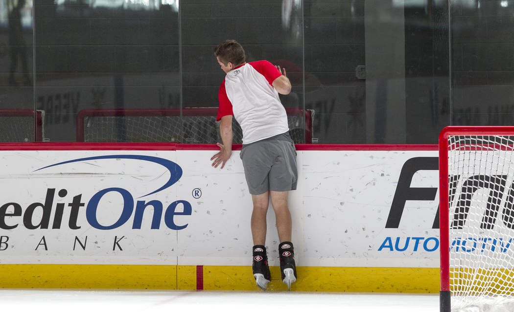 NASCAR Camping World Truck Series driver Noah Gragson hits the glass during an ice hockey skills clinic with Vegas Golden Knights TV analyst Shane Hnidy at the City National Arena on Friday, Sept. ...