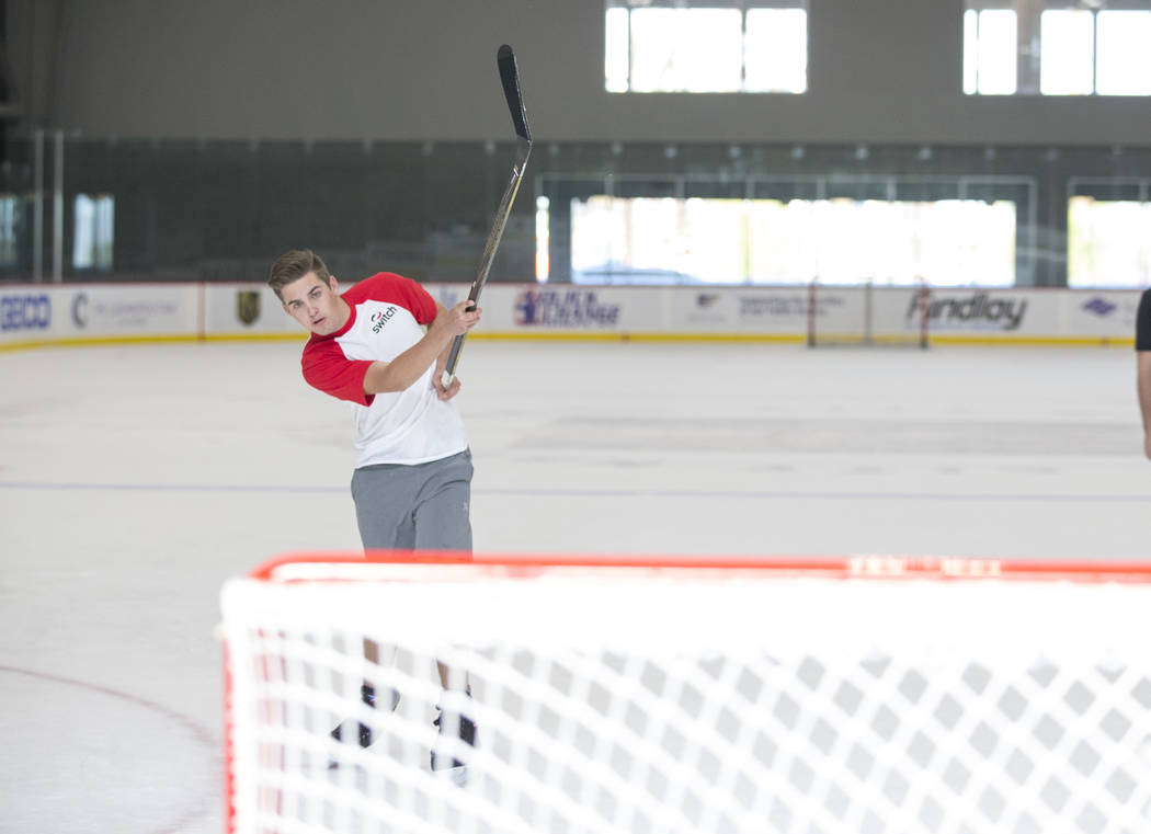 NASCAR Camping World Truck Series driver Noah Gragson shoots at the net during an ice hockey skills clinic with Vegas Golden Knights TV analyst Shane Hnidy at City National Arena on Friday, Sept.  ...