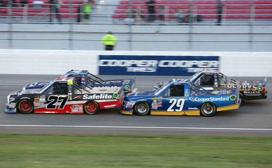 Chase Briscoe (29) trails Ben Rhodes (27) as they make makes their way around the track in the NASCAR Camping World Truck Series at Las Vegas Motor Speedway in Las Vegas, Saturday, Sept. 30, 2017. ...