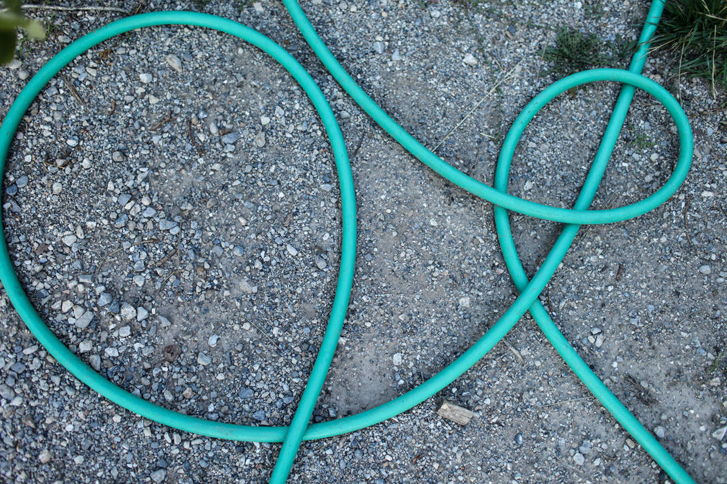 A water hose lays on the ground at the Rainbow Division in Mount Charleston, Monday, Sept. 18, 2017. Joel Angel Juarez Las Vegas Review-Journal @jajuarezphoto
