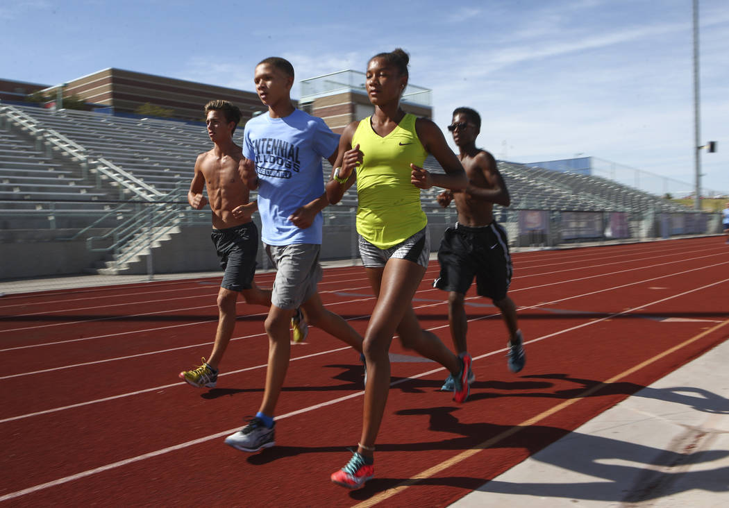 Centennial's Alexis Gourrier runs alongside her brother Jalen, to her left, during a track team practice at the high school in Las Vegas on Tuesday, Sept. 19, 2017. Chase Stevens Las Vegas Review- ...