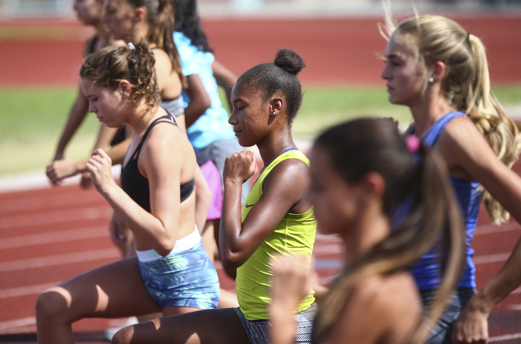 Centennial's Alexis Gourrier, center, warms up during a track team practice at the high school in Las Vegas on Tuesday, Sept. 19, 2017. Chase Stevens Las Vegas Review-Journal @csstevensphoto