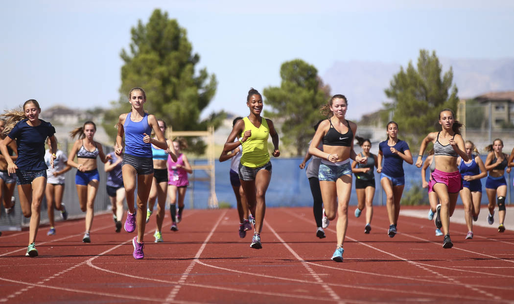 Centennial's Alexis Gourrier, center, runs through drills during a track team practice at the high school in Las Vegas on Tuesday, Sept. 19, 2017. Chase Stevens Las Vegas Review-Journal @csstevens ...