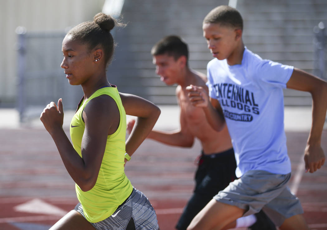 Centennial's Alexis Gourrier, left, runs alongside her brother Jalen during a track team practice at the high school in Las Vegas on Tuesday, Sept. 19, 2017. Chase Stevens Las Vegas Review-Journal ...
