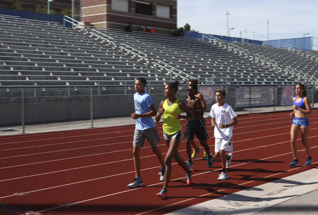 Centennial's Alexis Gourrier, center, runs alongside her brother Jalen, left, during a track team practice at the high school in Las Vegas on Tuesday, Sept. 19, 2017. Chase Stevens Las Vegas Revie ...