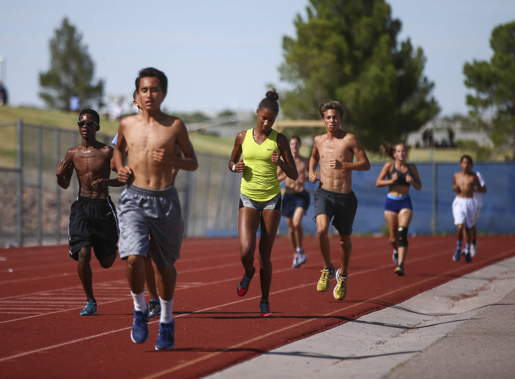Centennial's Alexis Gourrier, center, during a track team practice at the high school in Las Vegas on Tuesday, Sept. 19, 2017. Chase Stevens Las Vegas Review-Journal @csstevensphoto