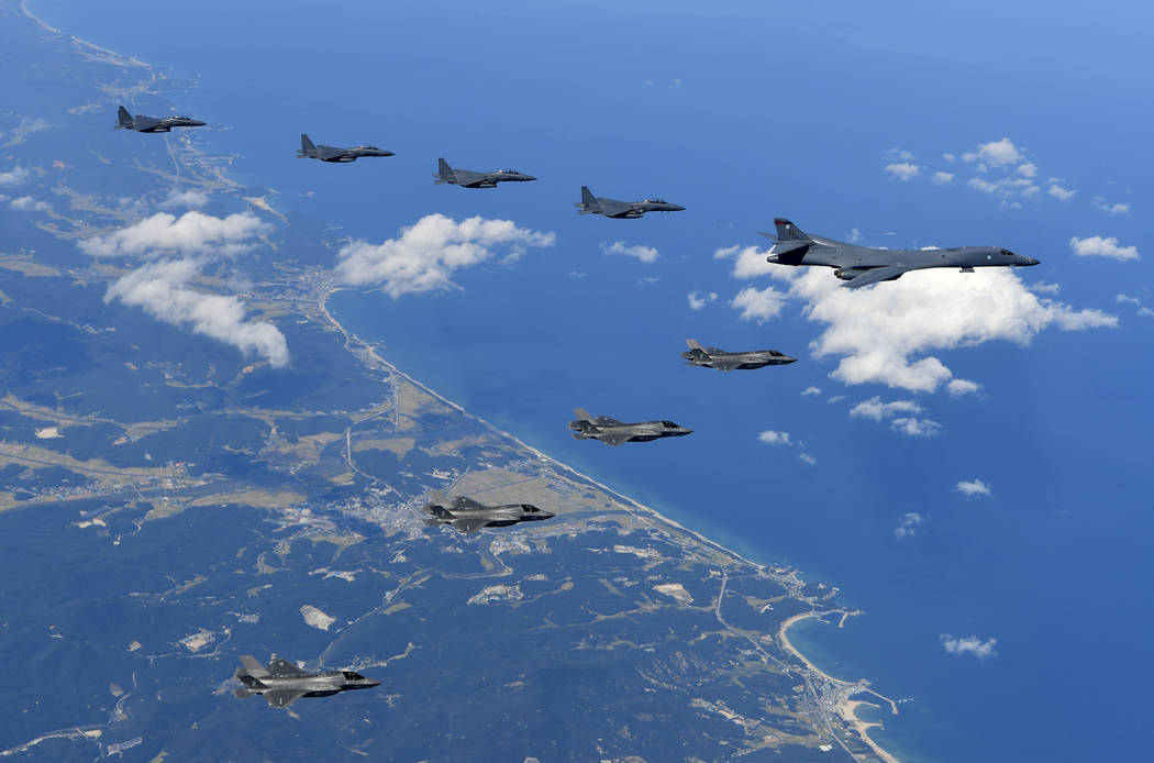 In this photo provided by South Korea Defense Ministry, U.S. Air Force B-1B bomber, F-35B stealth fighter jets and South Korean F-15K fighter jets fly over the Korean Peninsula during a joint dril ...