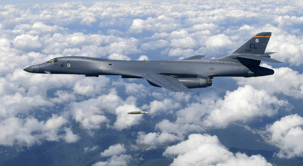 In this photo provided by South Korea Defense Ministry on Monday, Sept. 18, 2017, U.S. Air Force B-1B bomber drops a bomb as it flies over the Korean Peninsula during a joint drills, South Korea.  ...