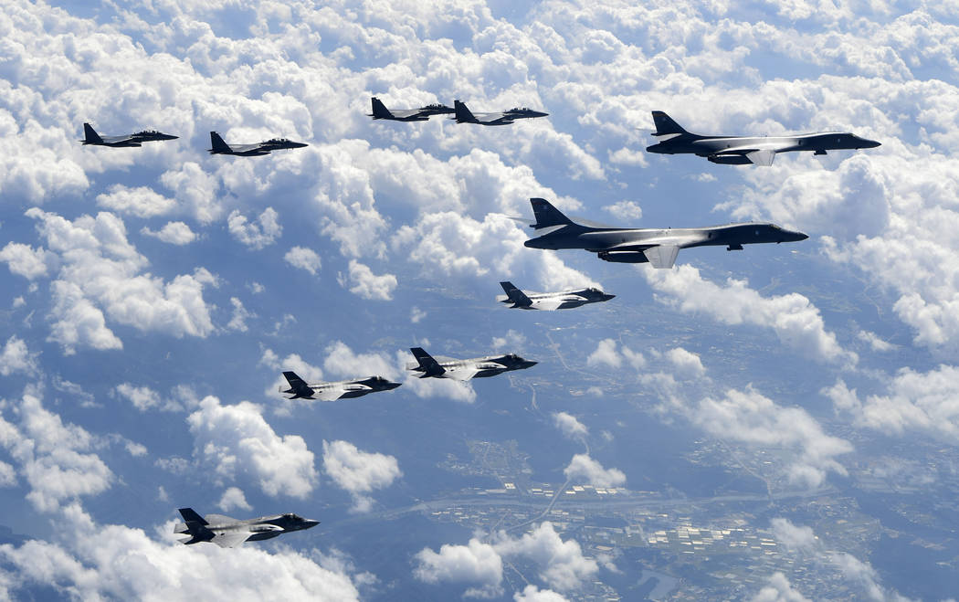 In this photo provided by South Korea Defense Ministry, U.S. Air Force B-1B bombers, F-35B stealth fighter jets and South Korean F-15K fighter jets fly over the Korean Peninsula during a joint dri ...