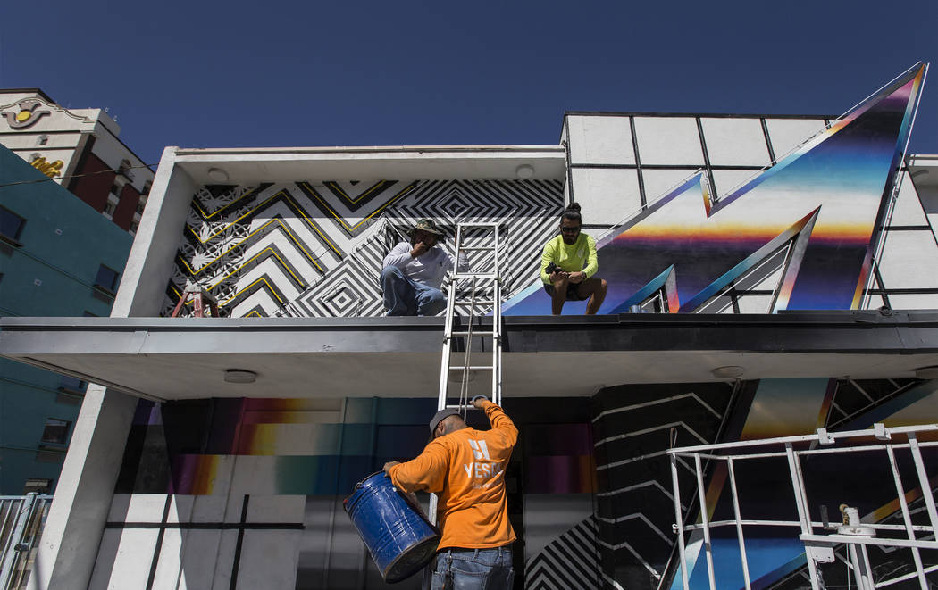 Yesco and Bombard Renewable Energy are updating Felipe Pantone's 2016 mural with a solar-powered neon installation for this year's Life is Beautiful festival. Photo taken on Monday, Septemb ...
