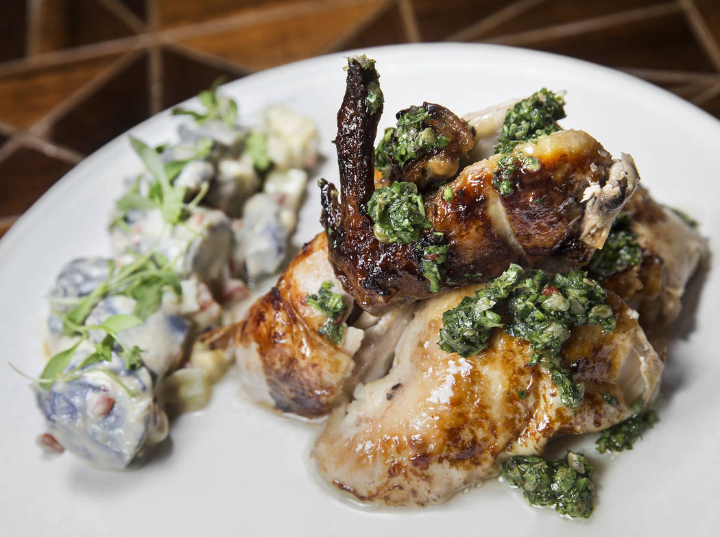 Meyer lemon rotisserie chicken with Peruvian purple potato salad at Chica on Thursday, September 22, 2017, at The Venetian hotel/casino, in Las Vegas. Benjamin Hager Las Vegas Review-Journal @benj ...