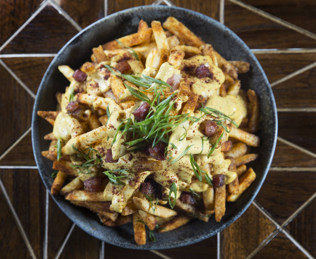 Chica fries with creamy huancaina, pancetta and scallions at Chica on Thursday, September 22, 2017, at The Venetian hotel/casino, in Las Vegas. Benjamin Hager Las Vegas Review-Journal @benjaminhphoto