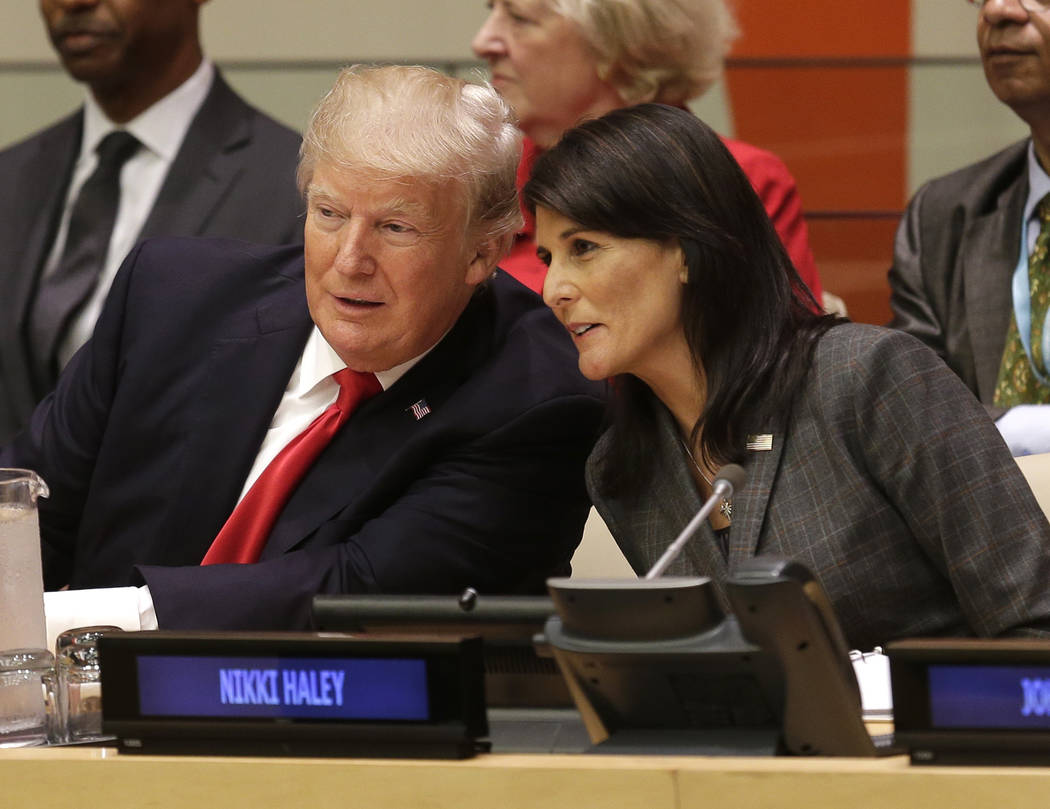 United States President Donald Trump speaks with U.S. Ambassador to the United Nations Nikki Haley before a meeting during the United Nations General Assembly at U.N. headquarters, Monday, Sept. 1 ...