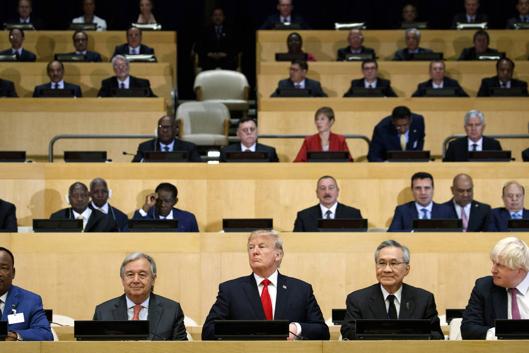 "President Donald Trump participates in a photo before the beginning of the ""Reforming the United Nations: Management, Security, and Development"" meeting during the United Nations ..."