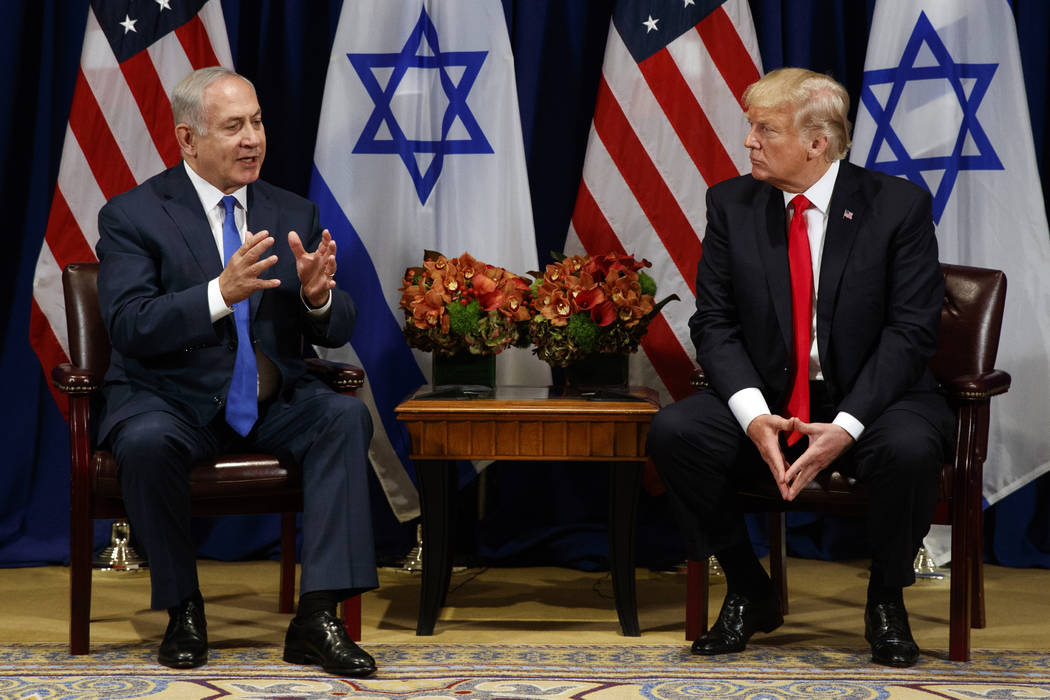 President Donald Trump listens to Israeli Prime Minister Benjamin Netanyahu during a meeting at the Palace Hotel during the United Nations General Assembly, Monday, Sept. 18, 2017, in New York. (A ...