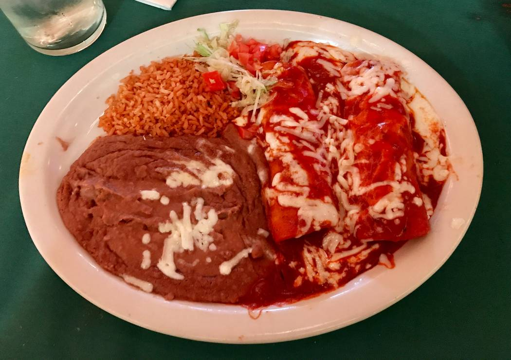 Chicken enchiladas with red sauce, beans and rice ($13). (Madelyn Reese/View) @MadelynGReese