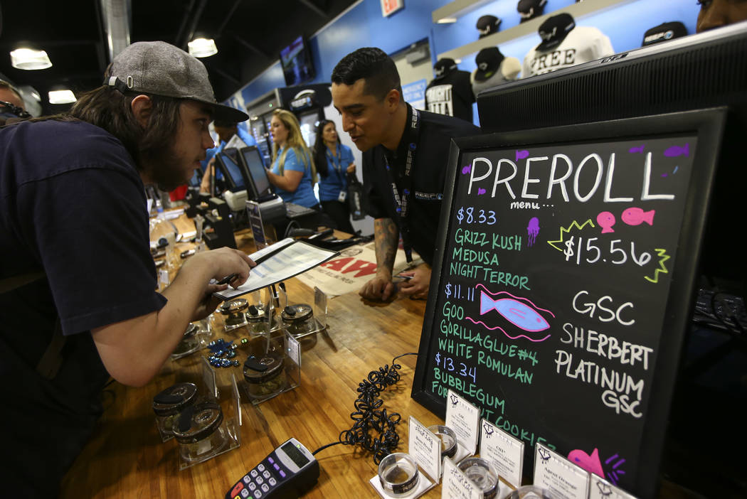 A customer looks through marijuana items as recreational sales become legal in Nevada at Reef Dispensaries in Las Vegas on Saturday, July 1, 2017. (Chase Stevens/Las Vegas Review-Journal) @cssteve ...