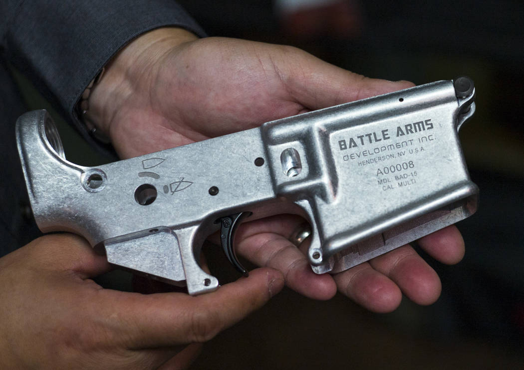 "Battle Arms Development President George Huang shows a firearm receiver with his company's name imprinted along with ""Henderson, NV U.S.A."" at the original location for the company at 180 Cassia W ..."