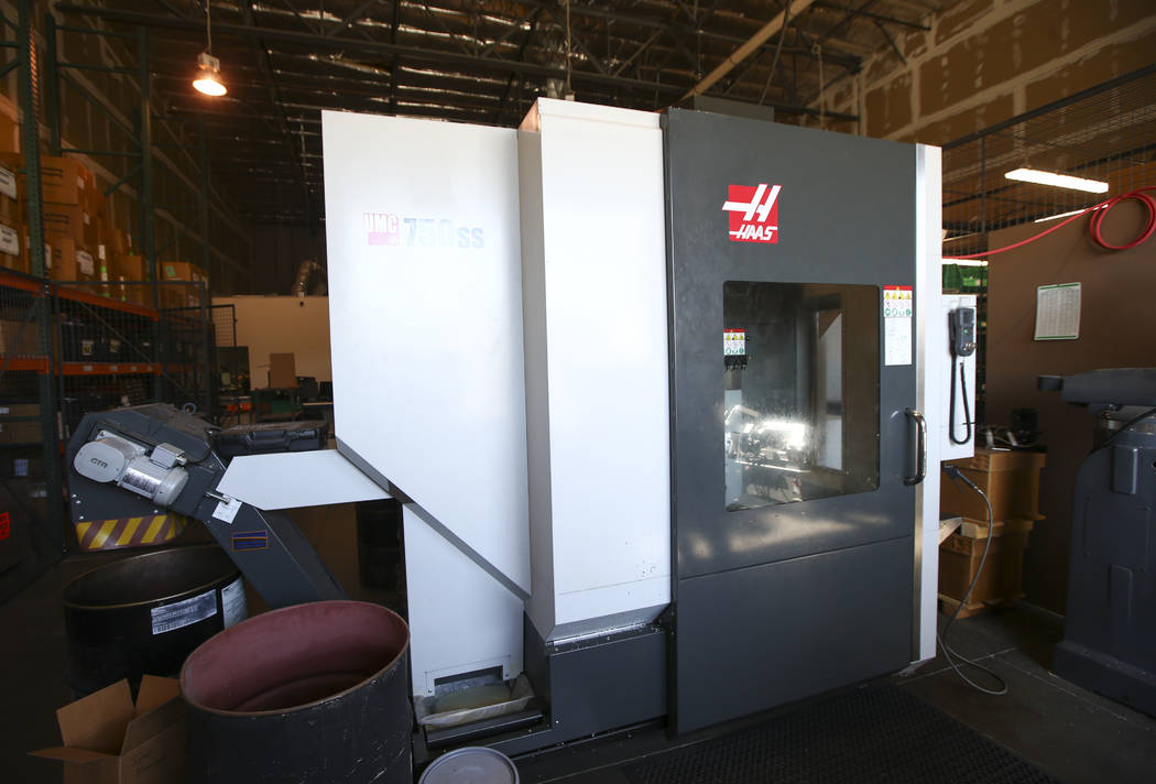 A five-axis computer-controlled cutting machine at Battle Arms Development is used for making firearm accessories at the company's original location at 180 Cassia Way in Henderson on Wednesday, Se ...
